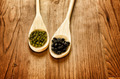 Soybeans and black beans in wooden spoons - PhotoDune Item for Sale