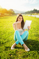 Happy teenage girl with tablet in nature - PhotoDune Item for Sale