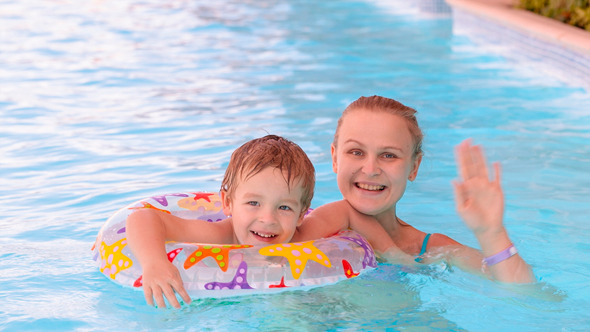 Mom And Son Swimming in Pool