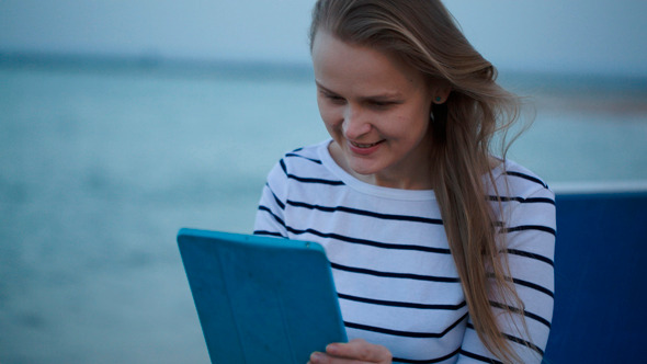 Young Woman Using Tablet Pc By Sea
