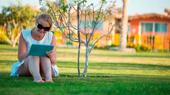Beautiful Woman Sitting Barefoot on A Lawn