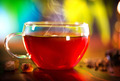 Cup of Healthy Tea over Nature Green background. Herbal Tea