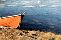 orange rescue boat on the shore of a frozen lake - PhotoDune Item for Sale