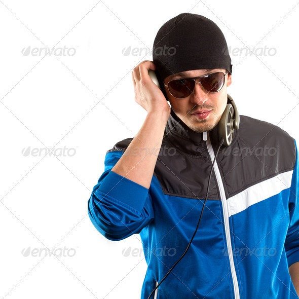 Man In Glasses With Headphones Looking At Camera   - Stock Photo - Images