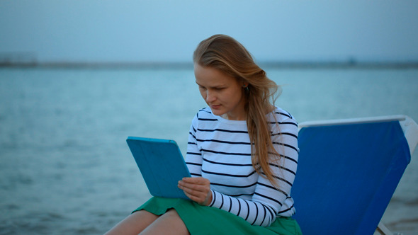 Woman With Touchpad By Sea