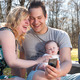 Young family is smiling while taking a selfie - PhotoDune Item for Sale