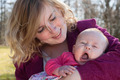Baby is yawning in mothers arms - PhotoDune Item for Sale