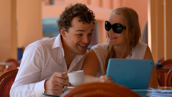 Man And Woman Watching Photos on Tablet Pc