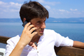 Young business man in vacation on the phone - PhotoDune Item for Sale