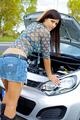 Gorgeous woman with broken engine worried - PhotoDune Item for Sale
