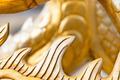 Golden sculpture close-up showing dragon spine. - PhotoDune Item for Sale