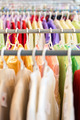Rows of colorful clothes on hangers at shop. - PhotoDune Item for Sale