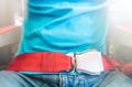 Man wearing red seat belt. Safety measures. - PhotoDune Item for Sale