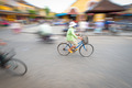 Person riding blue bike in Hoi An, Vietnam, Asia. - PhotoDune Item for Sale
