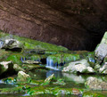 Stream Flowing Out of a Cave - PhotoDune Item for Sale