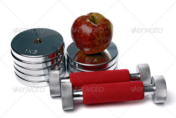 Barbells and apple isolated on white - Stock Photo - Images