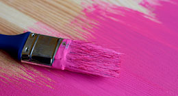 Pink paint and paintbrush