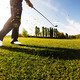 Golfer performs a golf shot from the fairway. - PhotoDune Item for Sale