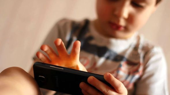 Portrait of A Child Playing with A Smartphone