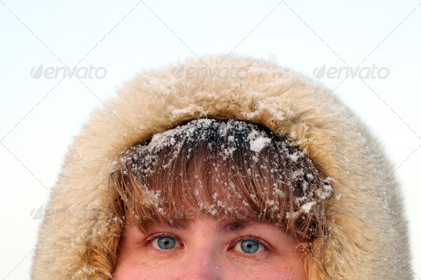 woman's blue eyes and hair under snow - Stock Photo - Images