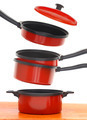 Red cookware set on white background