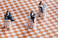 Miniature people sitting over a roadmap - PhotoDune Item for Sale