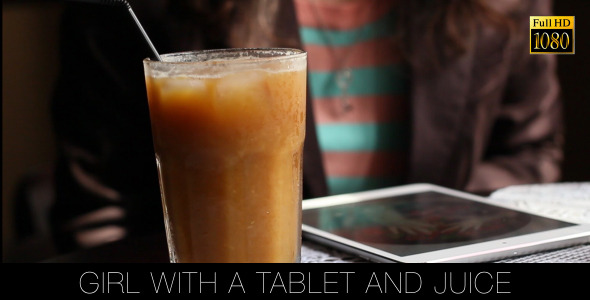 Girl With A Tablet And Juice