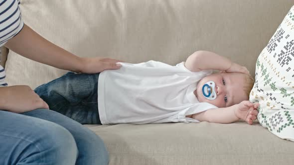 Download Sleepy Baby Lying on Sofa nulled download