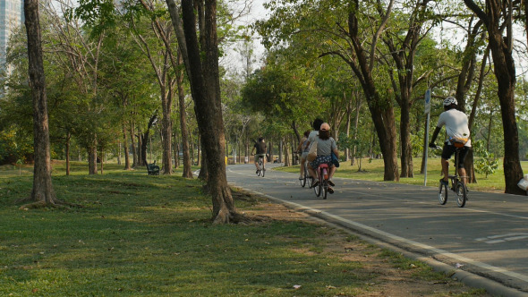 People Cycling In Park
