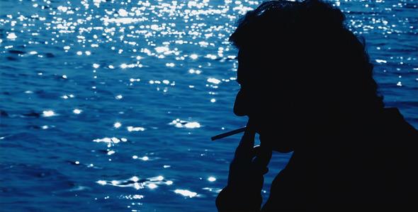 Man Smoking and the Sea