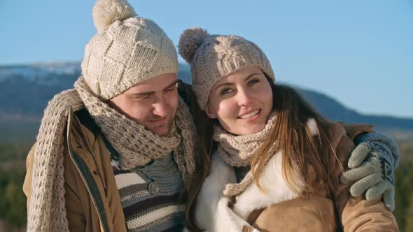 VideoHive Smiling Couple Taking Winter Photos 19322565