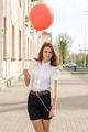 Beautiful fashion girl with red balloon on the street  - PhotoDune Item for Sale
