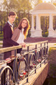 Young fashion stylish Hipster couple in love on the bridge lover - PhotoDune Item for Sale