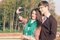 Young fashion stylish Hipster couple take a selfie - PhotoDune Item for Sale