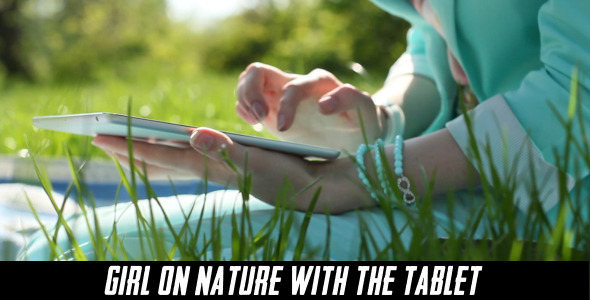 Girl On Nature With The Tablet 10