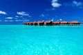 Overwater villas in blue tropical lagoon - PhotoDune Item for Sale