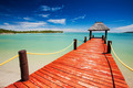 Wooden red jetty extending to tropical lagoon - PhotoDune Item for Sale