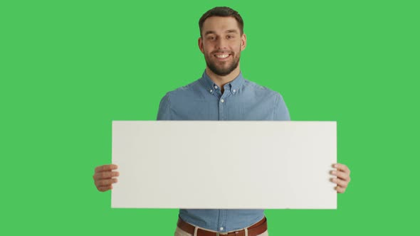 VideoHive Medium Shot of a Smiling Stylish Man Holding Poster Placard 19462446