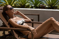 Young Woman Sunbathing. Resort And Spa. - PhotoDune Item for Sale