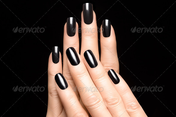 Woman hands with black nails