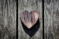 A wooden vintage heart on grunge wood planks. Symbol of love, - PhotoDune Item for Sale