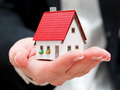 A real estate agent holding a small new house in her hands - PhotoDune Item for Sale