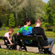 Family Sitting Near Pond - VideoHive Item for Sale