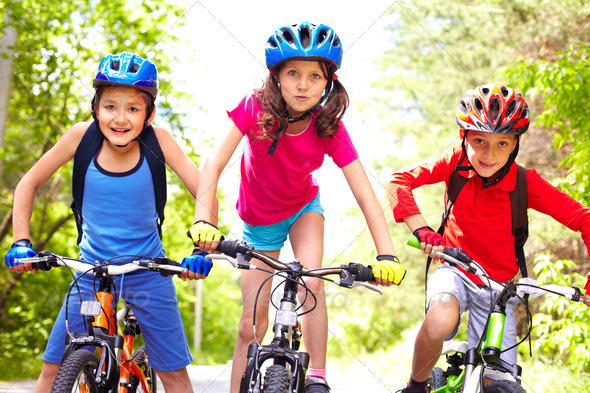 Children on bikes - Stock Photo - Images