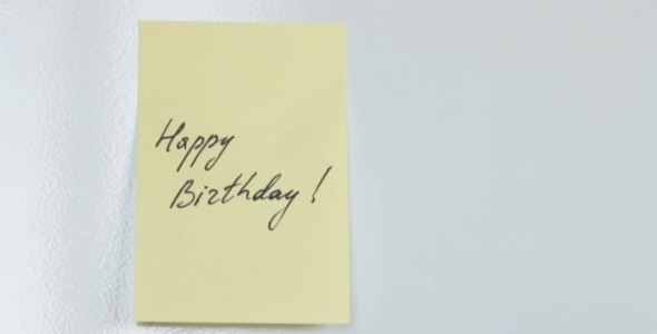 Happy Birthday Yellow Note on Fridge Door