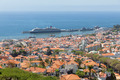 Aerial view of Portugese Funchal with a big cruise ship in the harbor - PhotoDune Item for Sale
