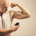 Fit young man applying antiperspirant spray deodorant - PhotoDune Item for Sale
