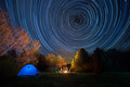 Tent against the night sky with tracks from stars - PhotoDune Item for Sale