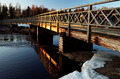 old wooden bridge over the river at sunset - PhotoDune Item for Sale