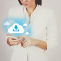 Businesswoman with smart phone downloading from cloud - PhotoDune Item for Sale